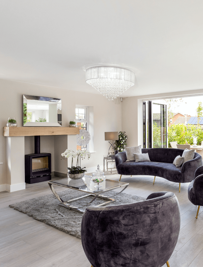 Alderbrook Road project modern seating area with a log burner that looks out onto the garden