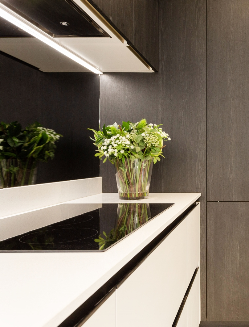 Tudor place project modern white kitchen with a vase of flowers