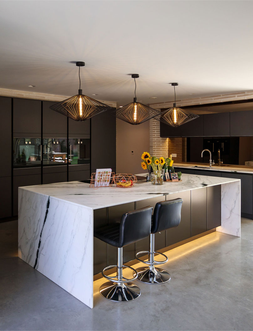Studio Spicer project Kitchen Island with waterfall countertop and 3 pendant lights above