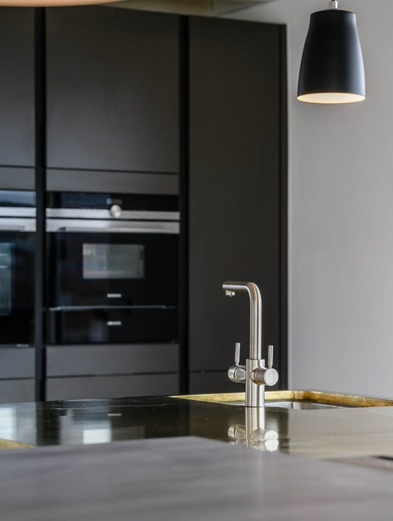 LIV Projekt soft focus onto the kitchen tap