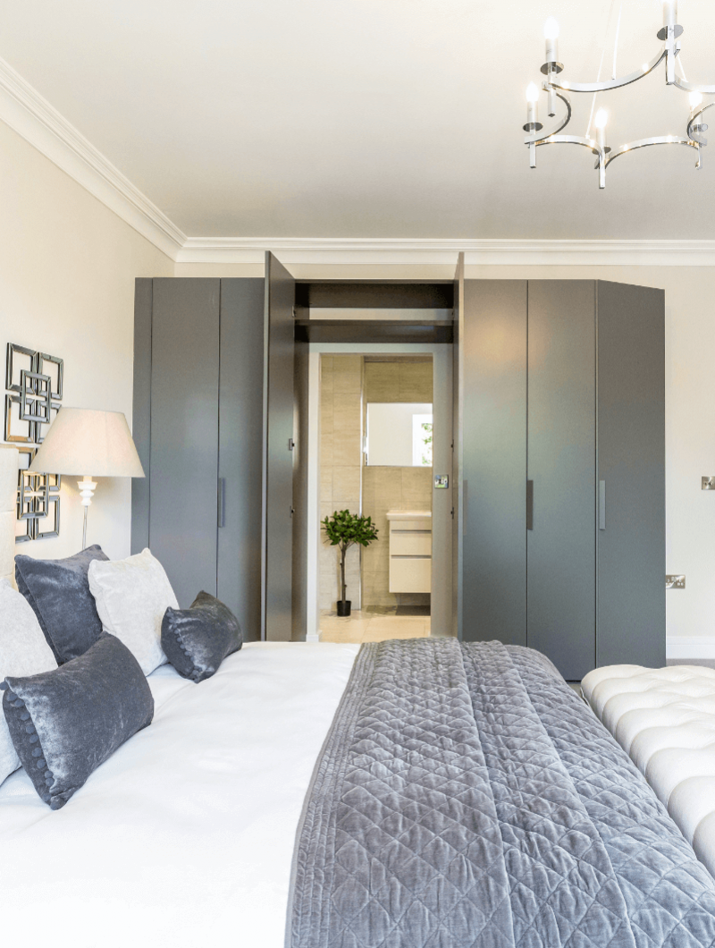 Alderbrook Road project Modern bedroom with ensuite hidden behind wardrobes