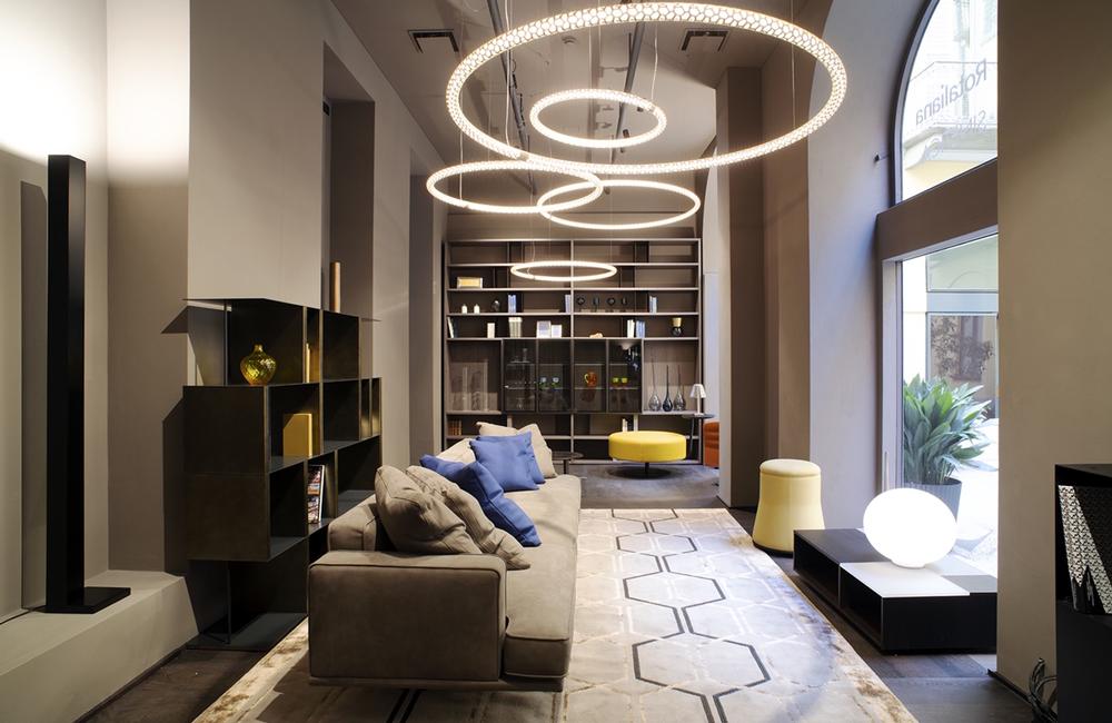 Jesse Milano Showroom with large comfy sofa and circular pendant lighting
