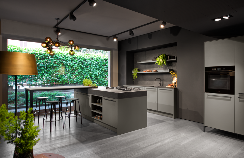 SieMatic URBAN kitchen in umbra with freestanding island, seating area, floatting shelves and herb garden