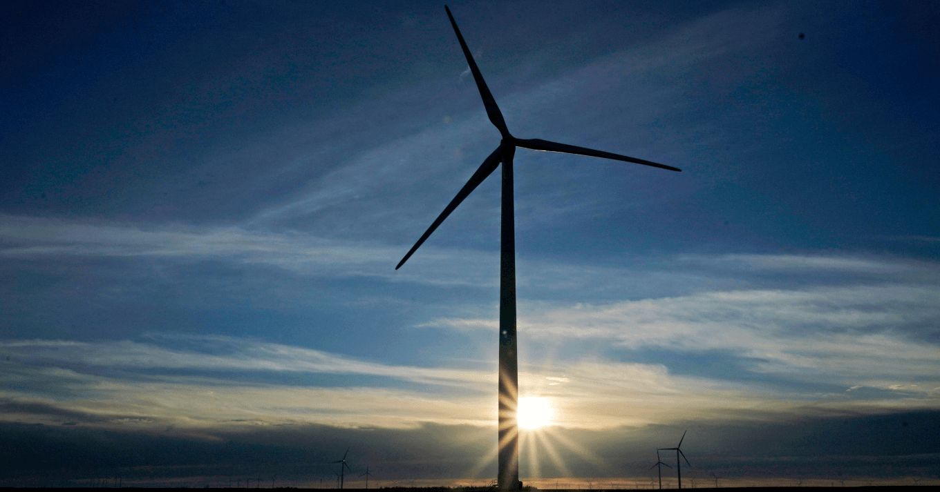 Wind turbine with a sunset behind
